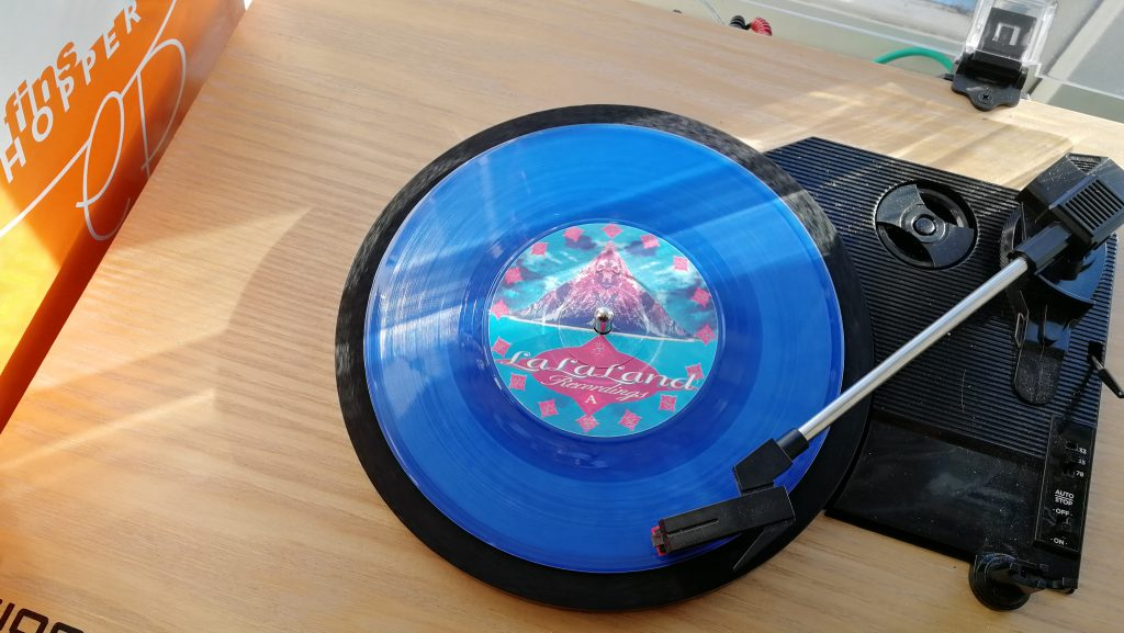 A blue record on a record player